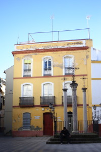 three crosses in front of yellow building in Sevilla
